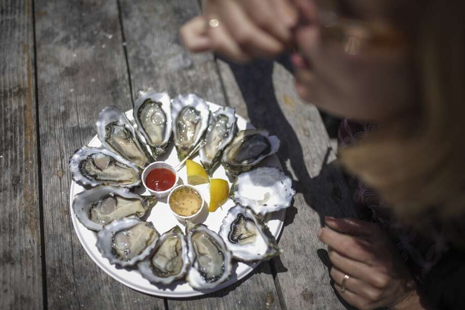 Saundra Weddle, from Springfield Missouri, eats an oyster at Drakes Bay Oyster Farm in Inverness on June 30th 2014. Photo: Sam Wolson, Special To The Chronicle