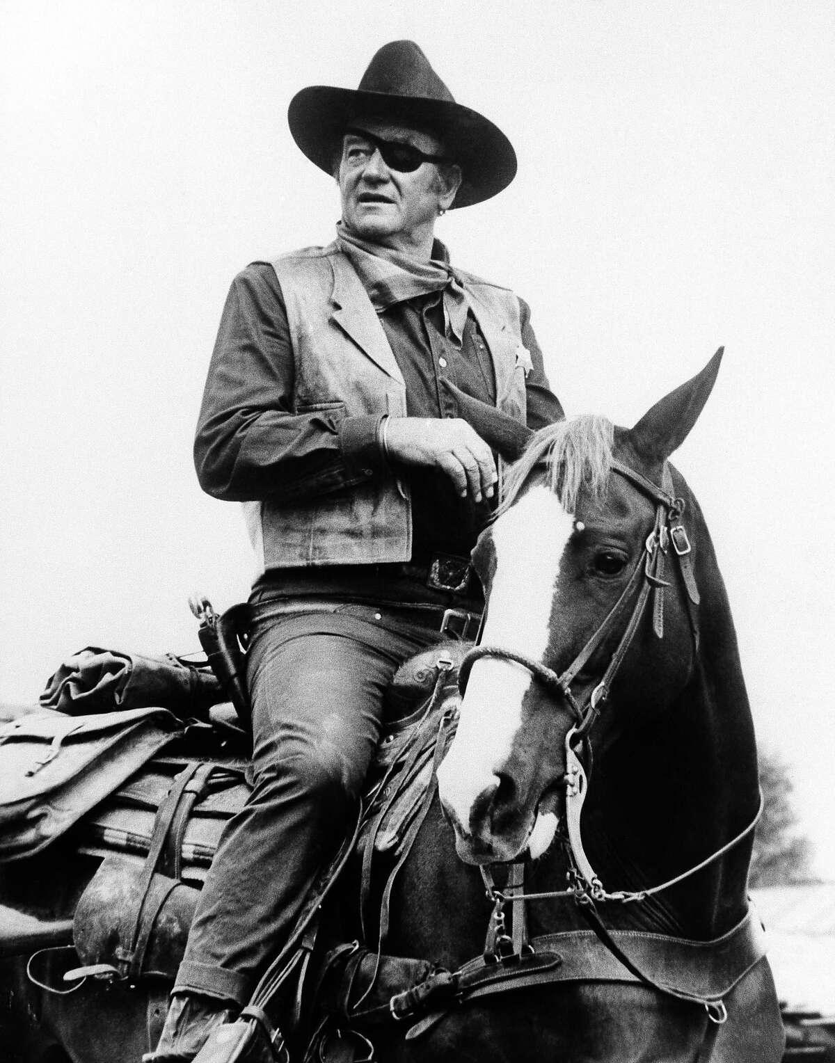"""John Wayne appears in a scene from """"True Grit."""""""