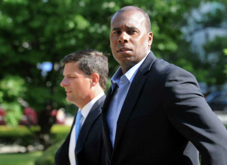 Former Ducks player Jose Offerman, right, and his attorney, Frank Riccio, Jr, arrive at the federal courthouse in Bridgeport, Conn. on Thursday, July 17, 2014. Offerman is being sued by former Bluefish catcher Jonathan Nathans for injuries sustained in a charging the mound incident in a 2007 game between the two teams. Photo: Autumn Driscoll / Connecticut Post