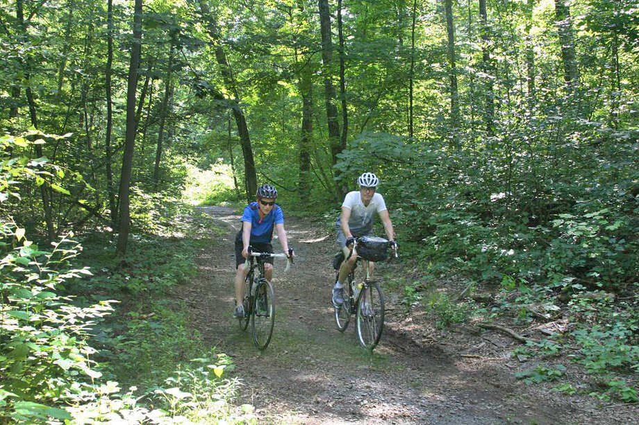Tom O'Brien and his son, Jake, 16, on a ride together at Sega Meadows Park, in New Milford, Conn. The park trail would be part of the Western New England Greenway, a planned bike trail that would run from Montreal, Canada to Long Island Sound. Photo: Contributed Photo / The News-Times Contributed