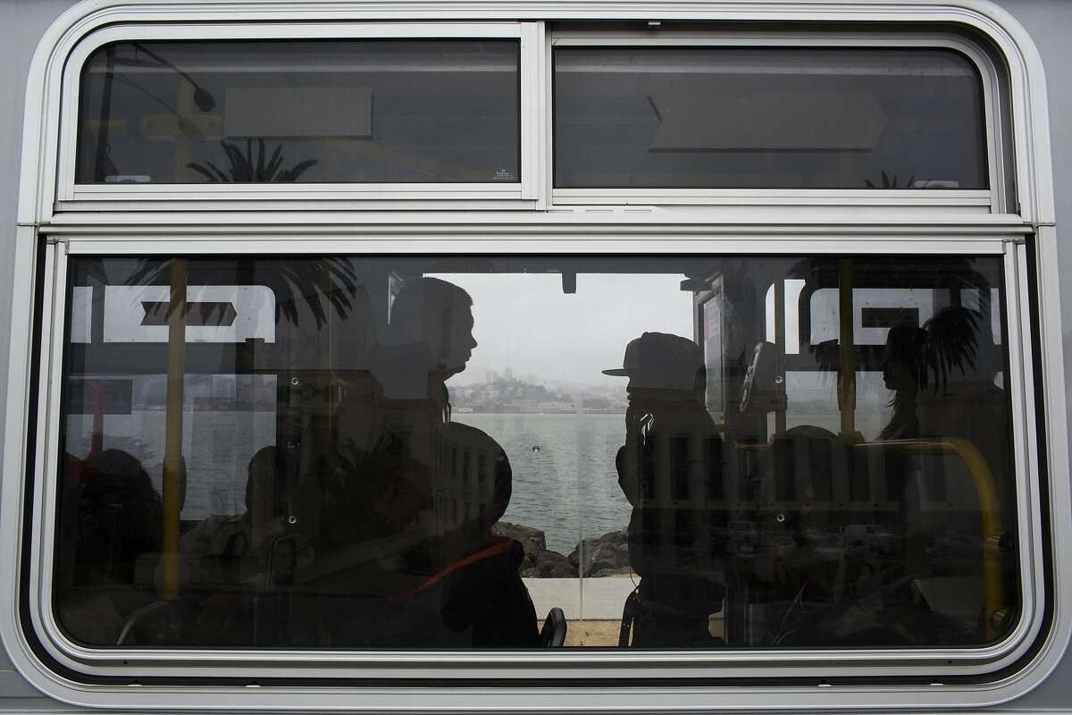 Passengers board bus 108 on Treasure Island Calif. on Friday, July 18, 2014. By 2018, when new houses are expected to be built on Treasure Island, transportation services will increase, including a ferry to San Francisco run by the Water Emergency Transit Authority.