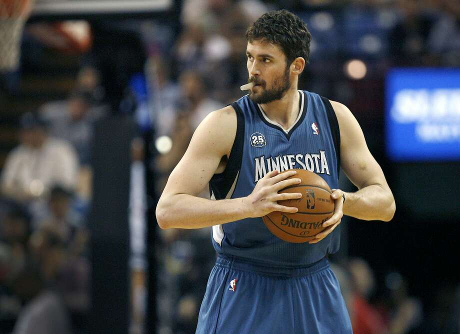 While Billy Beane, left, can swing a trade in minutes, NBA teams interested in dealing for Kevin Love, right, are having to work. Photo: Steve Yeater, Associated Press