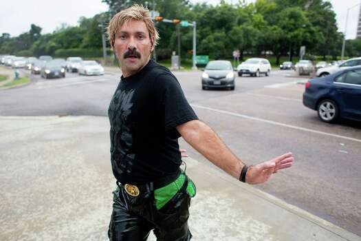 Juan Carlos skate dances on the corner of Montrose and Allen Parkway during rush hour where he has entertained passersby for the past 15 years Photo: Johnny Hanson, Staff / © 2014  Houston Chronicle