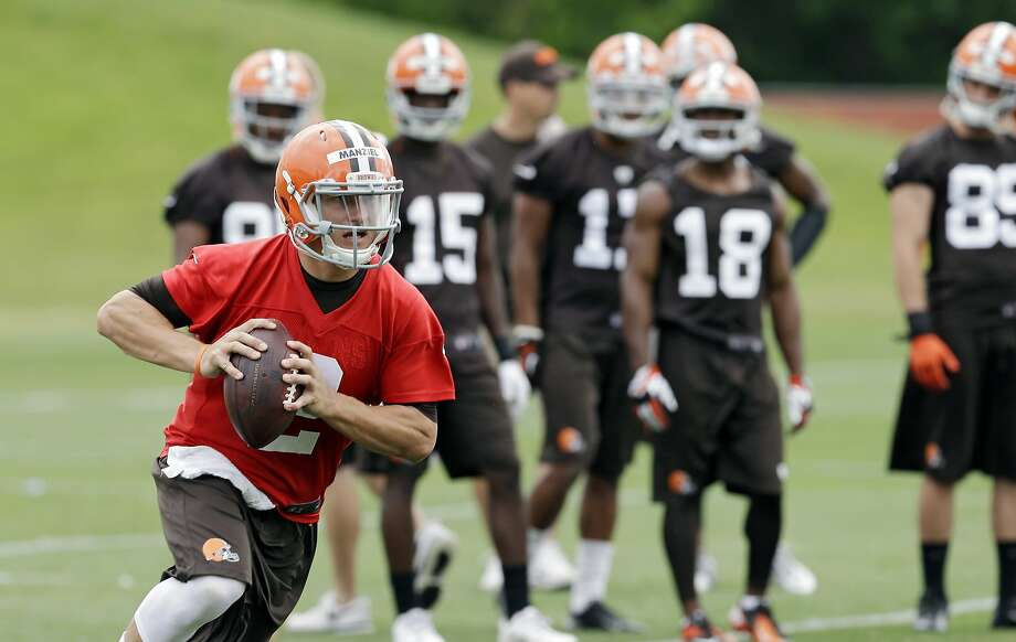 Rookie Johnny Manziel, who is competing to be the Browns' starting quarterback, won't have to scramble for attention in Cleveland - even with LeBron James back in town. Photo: Mark Duncan, Associated Press