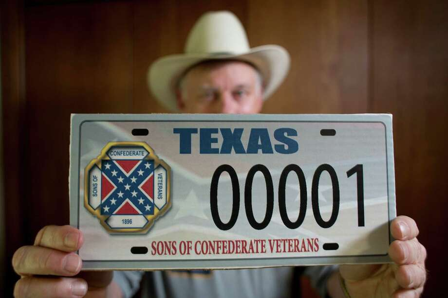 "Dr. Ray James, an engineering professor at Texas A&M University and one of about 2500 members of the Texas division of the Sons of Confederate Veterans shows the license plate the group with the Confederate ""battle flag"" on the group's registered logo that has become a legal battle with the Texas Department of Motor Vehicles Tuesday, July 15, 2014, in College Station. James' name is on the federal lawsuit the group filed against the State of Texas to force the Department of Motor Vehicles to issue specialized license plates with the group's symbol.  ( Johnny Hanson / Houston Chronicle ) Photo: Johnny Hanson, Staff / © 2014  Houston Chronicle"