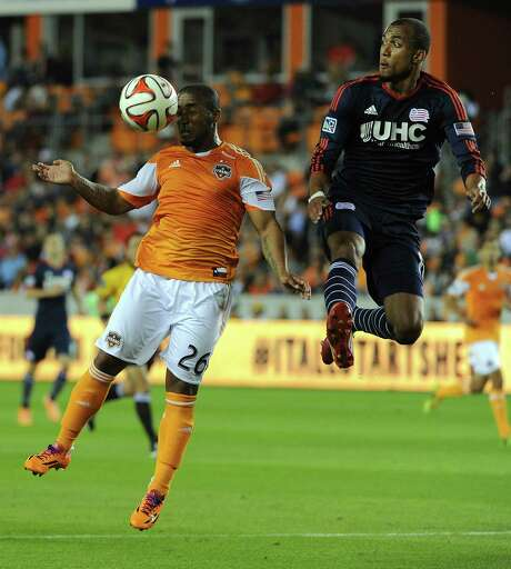 The Dynamo missed Corey Ashe, left, heading the ball in a match against New England, when he was out for three MLS games with a knee injury. Photo: Eric Christian Smith, Freelance