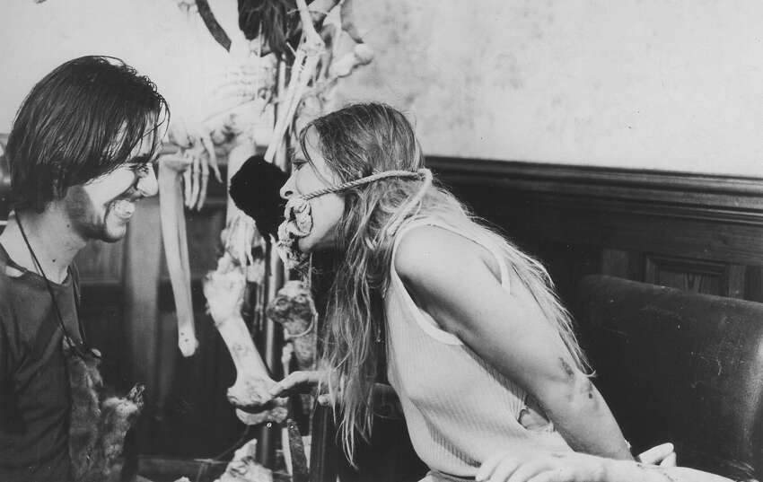Edwin Neal and Marilyn Burns in a scene from the original,