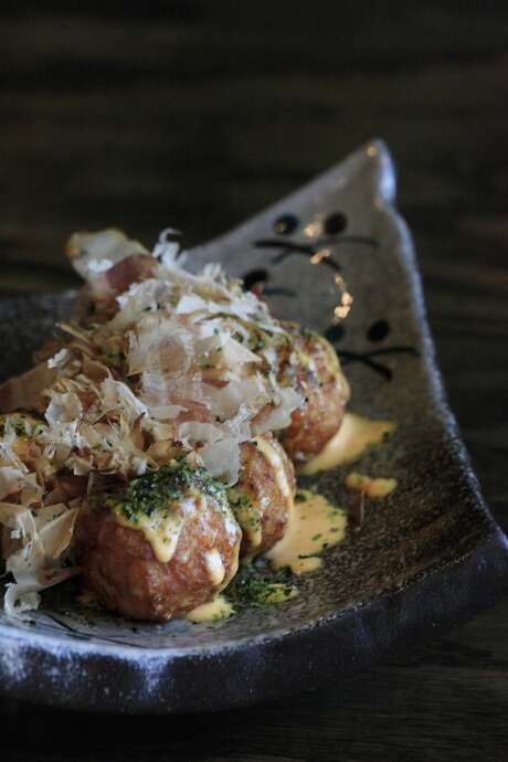 Orenchi Ramen's Age Takoyaki  is displayed on a table at Orenchi Ramen on Wednesday, July 9,  2014 in Santa Clara, Calif. Photo: Lea Suzuki, The Chronicle