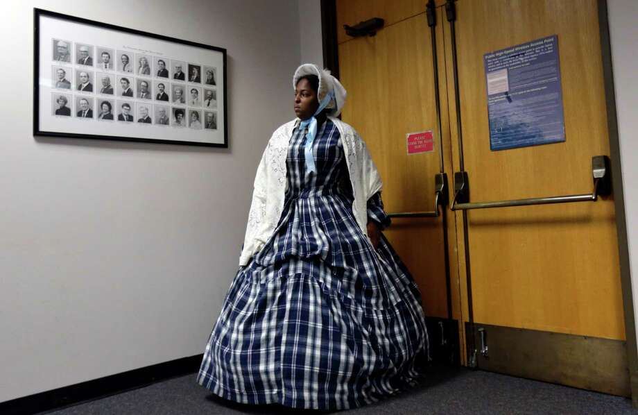 "Laura Pradia, of San Antonio, wears a period costume as she enters a Texas Board of Education meeting, Friday, July 18, 2014, in Austin, Texas.  The board heard testimony on history curriculum and voted unanimously to allow its members to take privately-funded trips to such schools in other states, which critics say would lead to ""junkets"" and conflicts of interest. (AP Photo/Eric Gay) Photo: Eric Gay, Associated Press / AP"