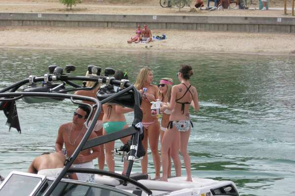 ** ADVANCE FOR SUNDAY, MARCH 22 ** A group of girls stand atop a boat during spring break in Lake Havasu City, Ariz. on Thursday, March 19, 2009. (AP Photo/Felicia Fonseca)