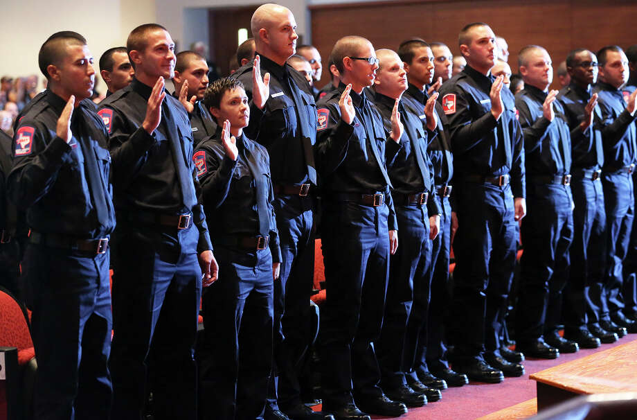 Cadets take the oath adminsitered by Chief Charles Hood during the San Antonio Fire Department Cadet Class 2014 Alpha graduation at Antonian College Preparatory High School Auditorium on Friday, July 18, 2014. Photo: TOM REEL