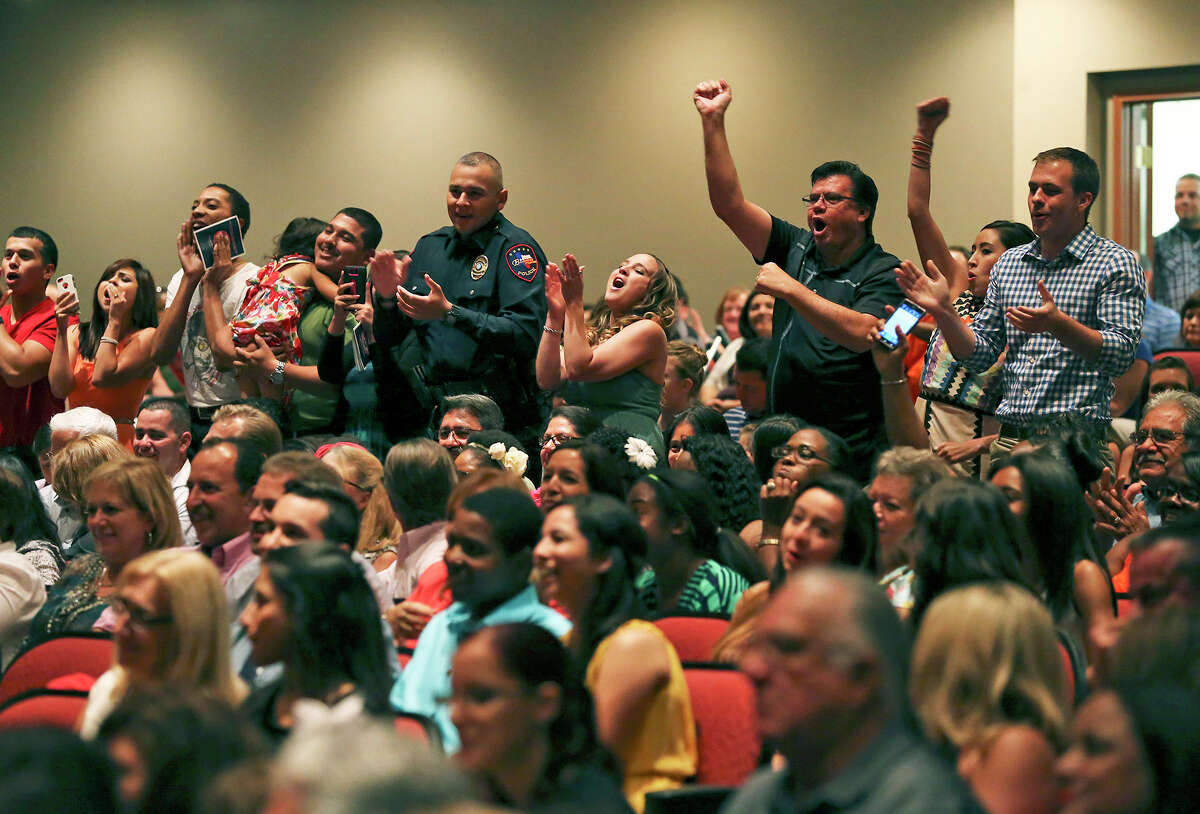 Family members cheer their graduates during the San Antonio Fire Department Cadet Class 2014 Alpha graduation at Antonian College Preparatory High School Auditorium on Friday, July 18, 2014.