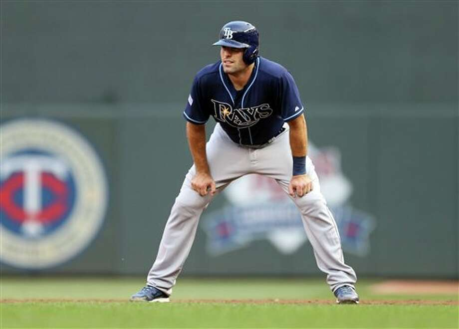 Tampa Bay Rays' CurtCasali takes a lead off first in the third inning of a baseball game against  the Minnesota Twins, Friday, July 18, 2014, in Minneapolis. The game was  Casali's major league debut.  (AP Photo/Jim Mone)