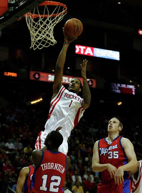 Trevor Ariza, above, has crossed paths with the Rockets' Dwight Howard and James Harden. Photo: Johnny Hanson, Staff / Houston Chronicle