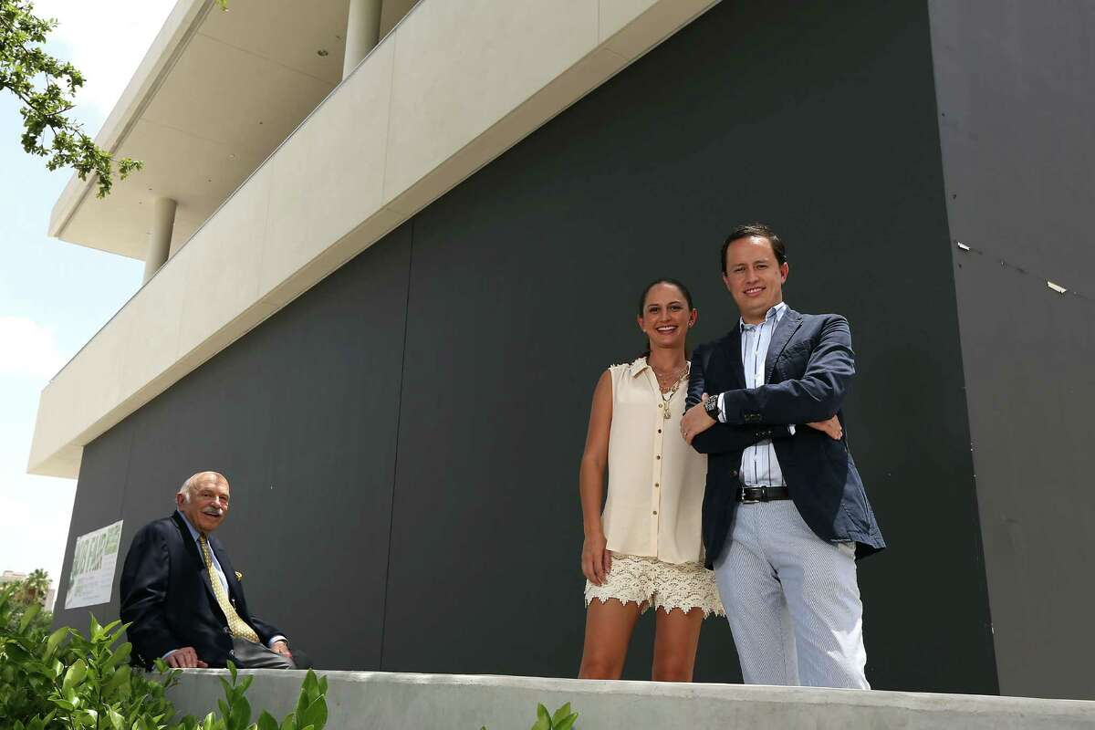 At the future location of Peska in BLVD Place are developer Ed Wulfe, with Maite Ysita and her brother Diego Ysita.