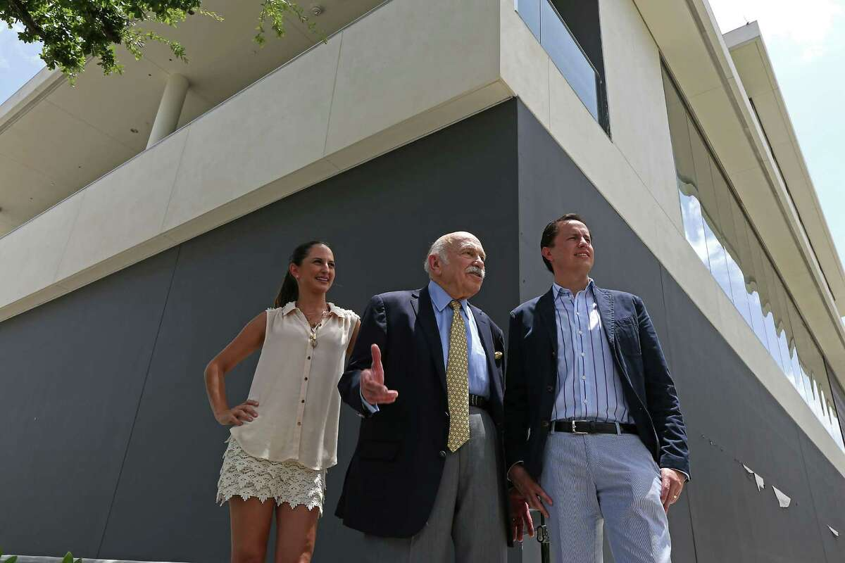 Maite Ysita left, Developer Ed Wulfe center, and Ysita's brother Diego Ysita right, pose for a portrait in front of the future location the Ysita's restaurant Peska Friday, July 11, 2014, in Houston. ( James Nielsen / Houston Chronicle )
