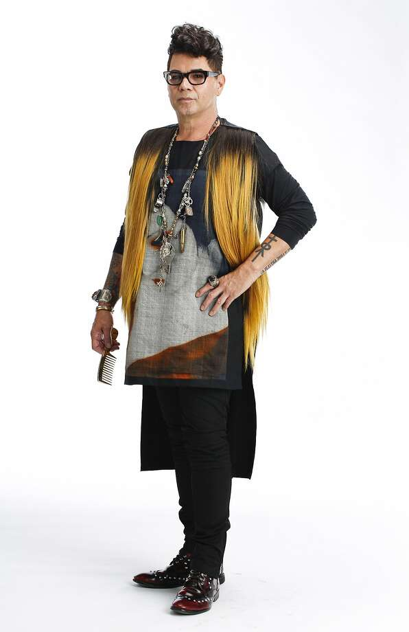 David Reposar, stylist and art director, is seen wearing a self-designed digital geisha tunic, human hair vest designed in collaboration with Nancy Bui, DeadRinger necklace assembled with charms collected from his world travels, a meteorite ring, and chunky amber cuff from Poland. Photo: Russell Yip, The Chronicle