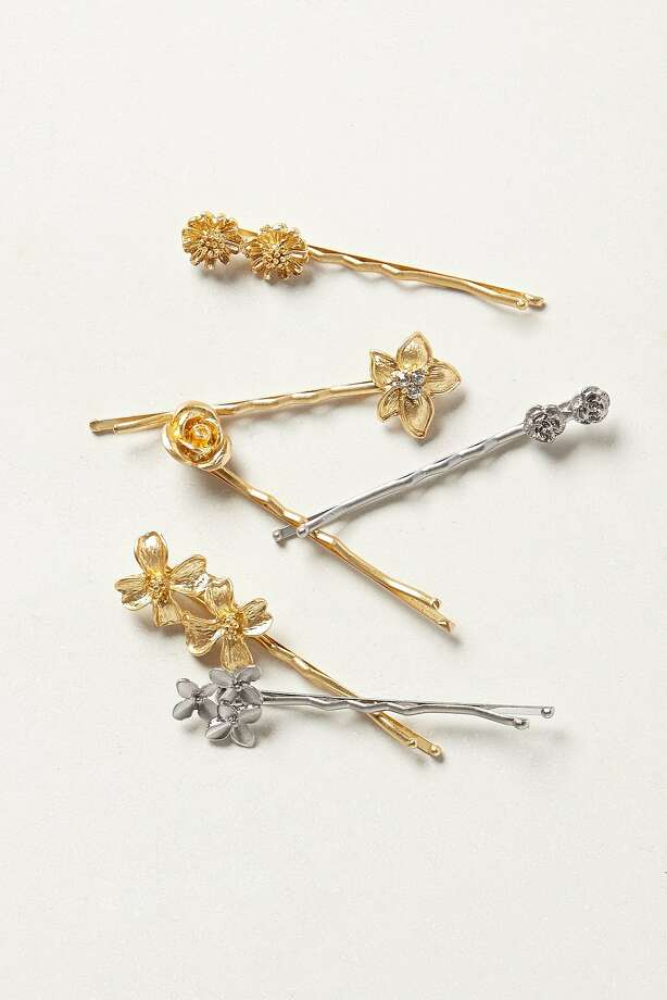 The metal and glass rosebuds perched atop these delicate hairpins lend retro glamour to modern-day updos. Rose Heath Bobby Set, $28,  www.anthropologie.com. Photo: Anthropologie.com