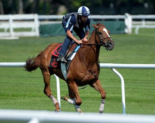 Two time Horse of the Year Wise Dan with exercise rider Damien Rock aboard breezes on the Oklahoma Training Center turf course Friday morning, July 18, 2014, in Saratoga Springs, N.Y.    (Skip Dickstein / Times Union) Photo: SKIP DICKSTEIN