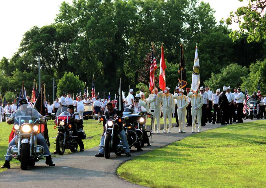 Members gather to march in the 96 annual American Legion convention parade on Friday evening, July 18, 2014 in Colonie N.Y. (Selby Smith/Special to the Times Union) Photo: Selby Smith / 00027600A