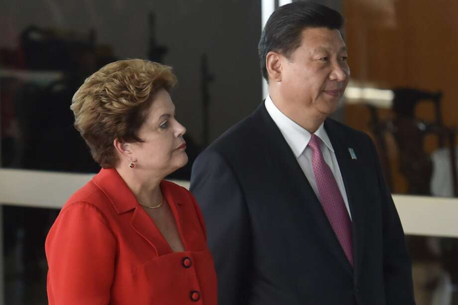 Brazilian President Dilma Rousseff and Chinese President Xi Jinping take part in a summit that created the New Development Bank, a rival to the U.S.-dominated World Bank and International Monetary Fund. Photo: NELSON ALMEIDA, Staff / AFP