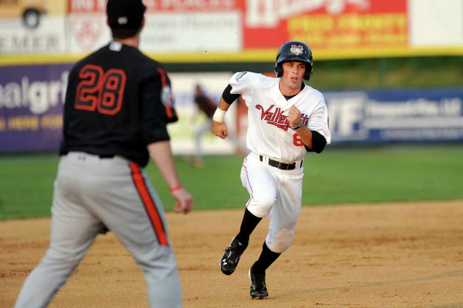 ValleyCats' Bobby Boyd, right, hustles to third as IronBirds' Hector Veloz waits for the play during their baseball game on Friday, July 18, 2014, at Joe Bruno Stadium in Troy, N.Y. (Cindy Schultz / Times Union) Photo: Cindy Schultz / 00027799A