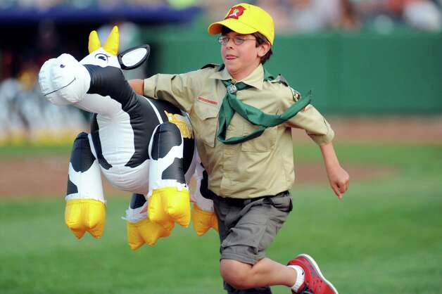 Ryan Darby, 11, of Scout Troop 277 runs his leg of the cow pasture race during a change up in the ValleyCats baseball game against the Aberdeen IronBirds on Friday, July 18, 2014, at Joe Bruno Stadium in Troy, N.Y. The race was held for the first time because of the Farm and Agriculture theme day. (Cindy Schultz / Times Union) Photo: Cindy Schultz / 00027799A