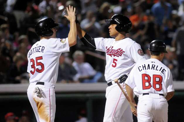 ValleyCats'  Terrell Joyce, center, celebrates a home run with teammate Ryan Bottger, left, during their baseball game against the Aberdeen IronBirds on Friday, July 18, 2014, at Joe Bruno Stadium in Troy, N.Y. (Cindy Schultz / Times Union) Photo: Cindy Schultz / 00027799A