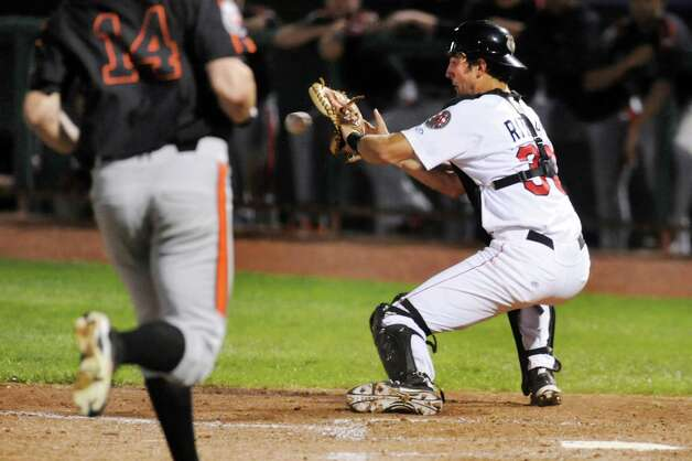ValleyCats'  catcher Jamie Ritchie, right, catches the ball but's too far off the base to tag out IronBirds' Steve Wilkerson during their baseball game on Friday, July 18, 2014, at Joe Bruno Stadium in Troy, N.Y. (Cindy Schultz / Times Union) Photo: Cindy Schultz / 00027799A