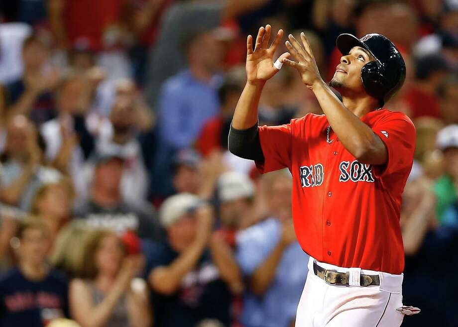 BOSTON, MA - JULY 18:  Xander Bogaerts #2 of the Boston Red Sox reacts at home plate after hitting a two-run home run in the sixth inning against the Kansas City Royals during the game at Fenway Park on July 18, 2014 in Boston, Massachusetts.  (Photo by Jared Wickerham/Getty Images) ORG XMIT: 477586395 Photo: Jared Wickerham / 2014 Getty Images