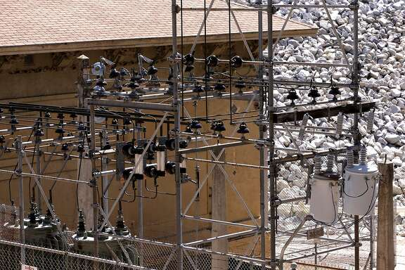 Bass Lake generates 27 megawatts of power through 5 downstream power houses including the Crane Valley power house, (pictured) as seen on Friday July 18, 2014, near Oakhurst, Calif. A prolonged drought could make it harder -- and more expensive -- for California to cut its greenhouse gas emissions and fight global warming. Drought cuts the amount of electricity that California gets from hydroelectric dams. To compensate, the state has to rely more on power plants burning natural gas.