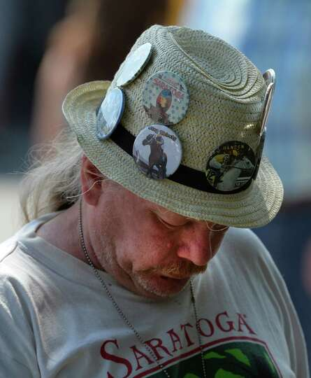 Race patron Ted Geissensetter enjoys a quiet moment on opening day Friday afternoon, July 18, 2014,