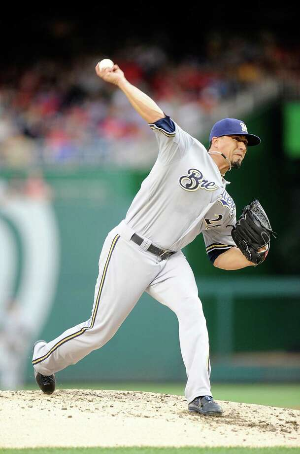 WASHINGTON, DC - JULY 18: Kyle Lohse #26 of the Milwaukee Brewers pitches in the second inning against the Washington Nationals at Nationals Park on July 18, 2014 in Washington, DC. (Photo by Greg Fiume/Getty Images) ORG XMIT: 477586425 Photo: Greg Fiume / 2014 Getty Images