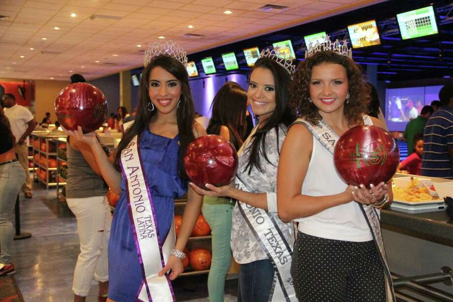 Party goers mingle and bowl with local and national celebrities for a good cause at the Main Event Entertainment Friday.  The celebrities included Miss San Antonio queens and Tampa Bay football players who attended the event hosted by Gold Medal winner and reality star Sanya Richards Ross and Super bowl Champ and Fox Tech Alumni Aaron Ross in benefit of the Believers united Christian ministry. Photo: By Jacob Beltran, For MySA.com