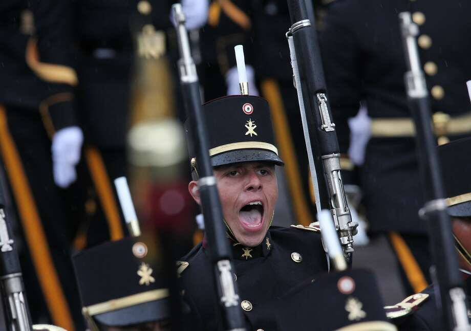 A cadet shouts out during a military parade in honor of a visit by Peru's President Ollanta Humala, to the Military College in Mexico City, Friday, July 18, 2014. Humala is in Mexico on an official visit. (AP Photo/Marco Ugarte) Photo: Marco Ugarte, Associated Press