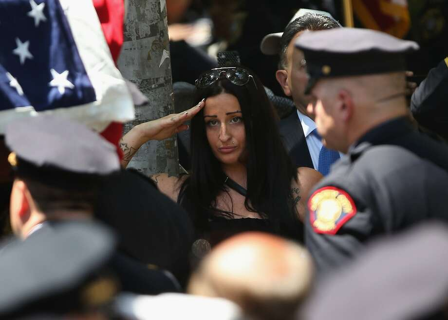 JERSEY CITY, NJ - JULY 18:  People watch as the flag-draped coffin of slain Jersey City police officer Melvin Santiago, 23, passes by following a funeral mass on July 18, 2014 in Jersey City, New Jersey. Police from the New Jersey and New York area took part in a procession and for Santiago, who was shot and killed in the line of duty during an armed robbery.  (Photo by John Moore/Getty Images) *** BESTPIX *** Photo: John Moore, Getty Images