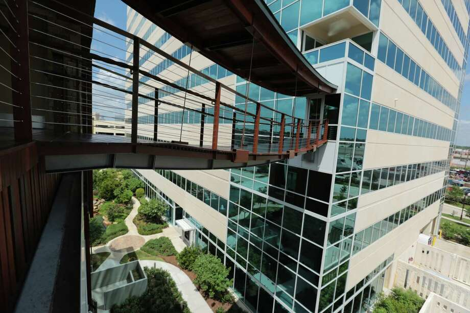 "A bridge from ""the Treehouse"" stretches to the Nexen Tower in the Memorial City area. The new building represents ""a collaborative and sustainable office of the future,"" MetroNational says. Photo: Billy Smith II / © 2014 Houston Chronicle"