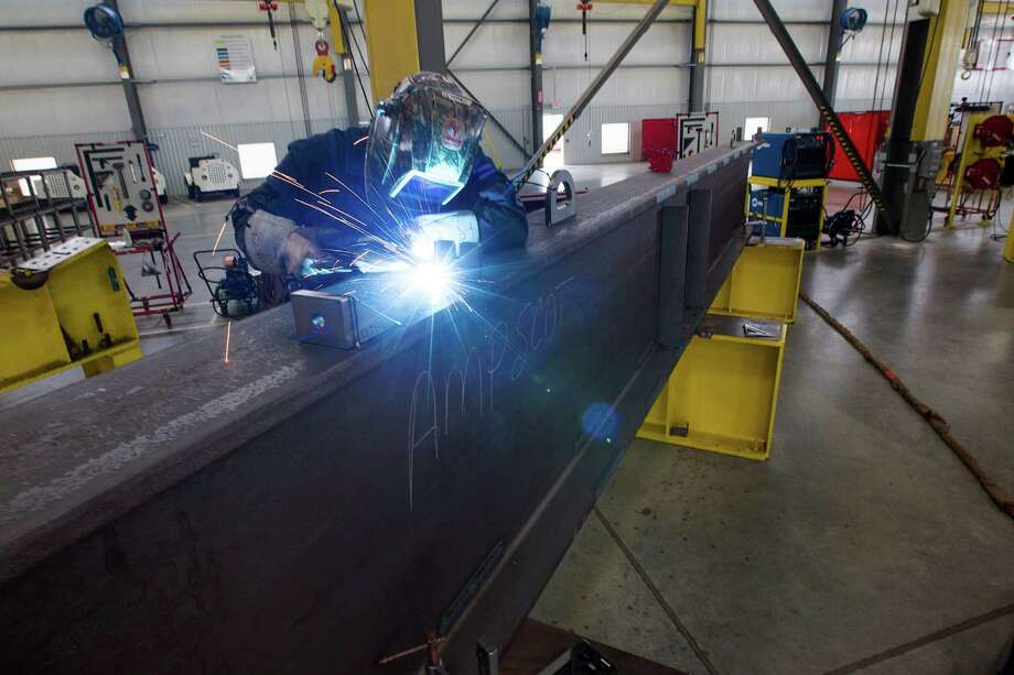 Skilled welders can make a lot of money in the Houston area these days with all the new structures coming up in Houston. Someone has to make sure all that steel sticks together.  Photo: Brett Coomer, Staff / © 2014 Houston Chronicle