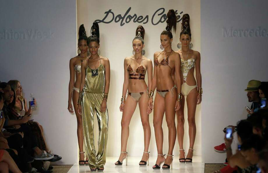 Models pose on the runway wearing swimwear designed by Dolores Cortes during the Mercedes-Benz Fashion Week Swim show, Friday, July 18, 2014, in Miami Beach, Fla. Photo: Lynne Sladky, AP / AP