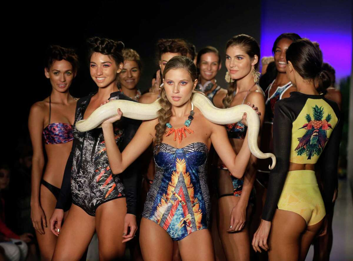 Models walk down the runway wearing swimwear designed by We Are Handsome during the Mercedes-Benz Fashion Week Swim show, Friday, July 18, 2014, in Miami Beach, Fla.