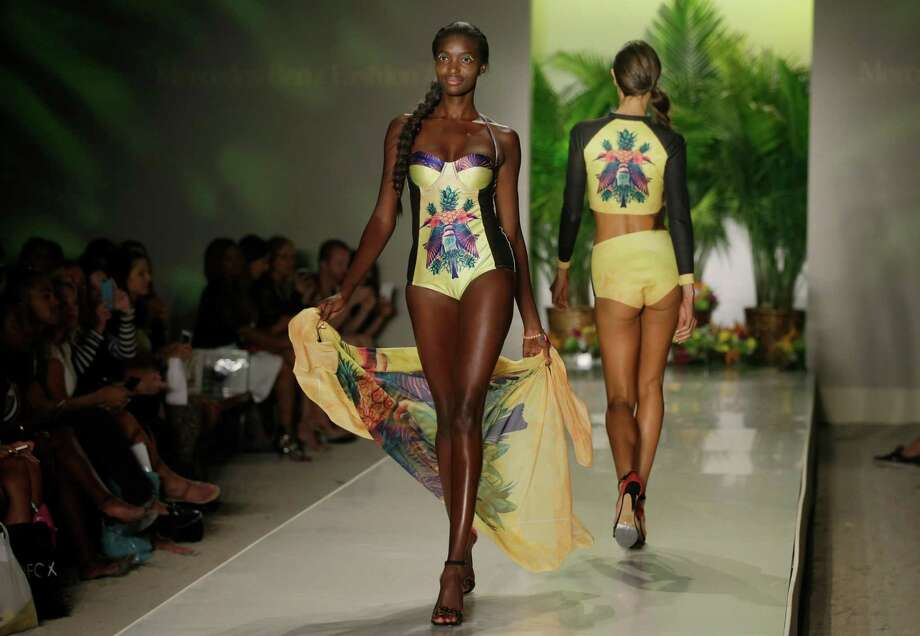 Models walk down the runway wearing swimwear designed by We Are Handsome during the Mercedes-Benz Fashion Week Swim show, Friday, July 18, 2014, in Miami Beach, Fla. Photo: Lynne Sladky, AP / AP
