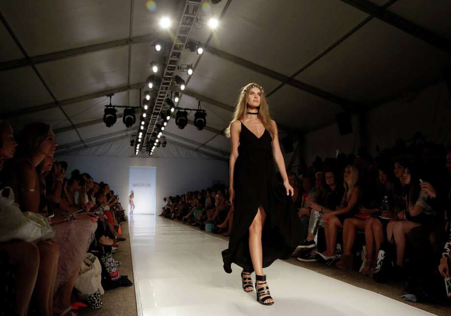 A model walks down the runway wearing swimwear designed by Wildfox during the Mercedes-Benz Fashion Week Swim show, Friday, July 18, 2014, in Miami Beach, Fla. Photo: Lynne Sladky, AP / AP