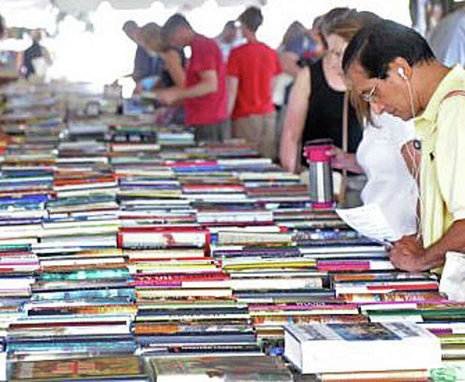 Thousands of books, and thousands of book lovers, will converge today at the Westport Library for the first day of its four-day sale. Hours are 9 a.m. to 6 p.m. Photo: File Photo / Westport News