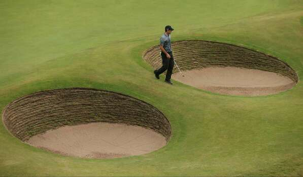 Charl Schwartzel of South Africa walks to a bunker on the 18th green to play his shot during the third day of the British Open Golf championship at the Royal Liverpool golf club, Hoylake, England, Saturday July 19, 2014. (AP Photo/Peter Morrison) Photo: Peter Morrison, Associated Press / AP