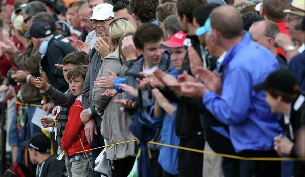 Young golf fans applaud as they wait for Rory McIlroy of Northern Ireland to pass by on the 17th hole during the third day of the British Open Golf championship at the Royal Liverpool golf club, Hoylake, England, Saturday July 19, 2014. (AP Photo/Jon Super) Photo: Jon Super, Associated Press / AP
