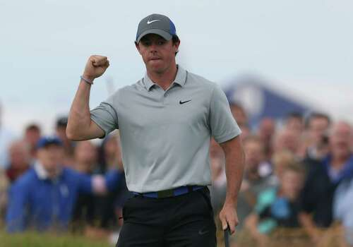 Rory McIlroy of Northern Ireland celebrates after playing an eagle on the 16th hole during the third day of the British Open Golf championship at the Royal Liverpool golf club, Hoylake, England, Saturday July 19, 2014. (AP Photo/Jon Super) Photo: Jon Super, Associated Press / AP