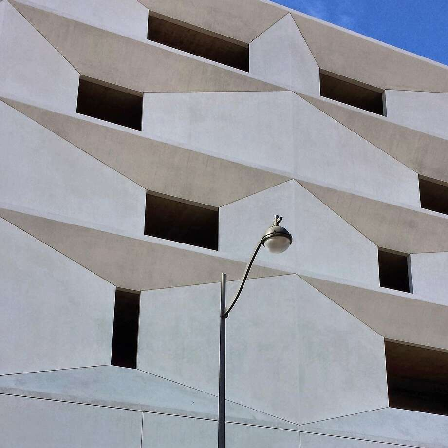 """San Francisco photographer Timothy Keller shot this wonderfully graphic image in the Mission Bay development. """"It's one of my favorite places to explore when I'm on the hunt for an Instagram pic. The light was at a certain angle and when I looked up, this parking garage caught my eye. Its highlight and shadow accentuated the geometric forms and the graceful lamp post was just an added bonus. Follow Keller on Instagram with the tag @tomothyk and if you would like to have your photo considered for publication, put it on your Instagram feed with hashtag #howsfseessf. We will let you know if we want to publish it. Photo: Timothy Keller, Special To The Chronicle"""