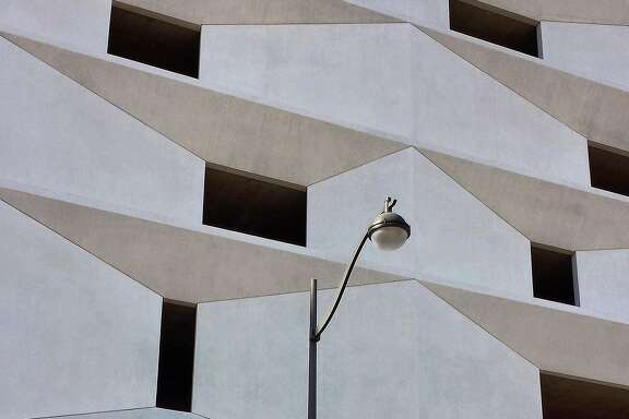 """San Francisco photographer Timothy Keller shot this wonderfully graphic image in the Mission Bay development. """"It's one of my favorite places to explore when I'm on the hunt for an Instagram pic. The light was at a certain angle and when I looked up, this parking garage caught my eye. Its highlight and shadow accentuated the geometric forms and the graceful lamp post was just an added bonus. Follow Keller on Instagram with the tag @tomothyk and if you would like to have your photo considered for publication, put it on your Instagram feed with hashtag #howsfseessf. We will let you know if we want to publish it."""