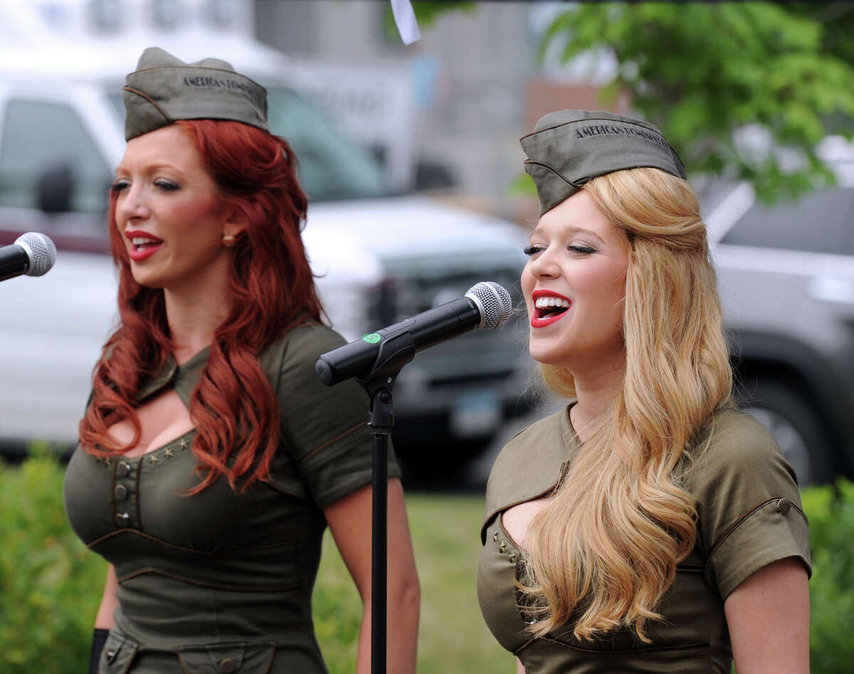American Bombshell singers, Rayna Bertash, left, and Dolly Leone entertain during the Stamford Firefighter Cook-Off at Fairway Market in Stamford, Conn., Saturday afternoon, July 19, 2014. The Belltown Fire Department took first place.