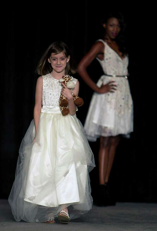Model walk the runway during the Damsel White Label bridal fashion show at the 30th Bi-Annual Bridal Extravaganza Show at the George R. Brown Convention Center. Photo: James Nielsen, Houston Chronicle / © 2014  Houston Chronicle